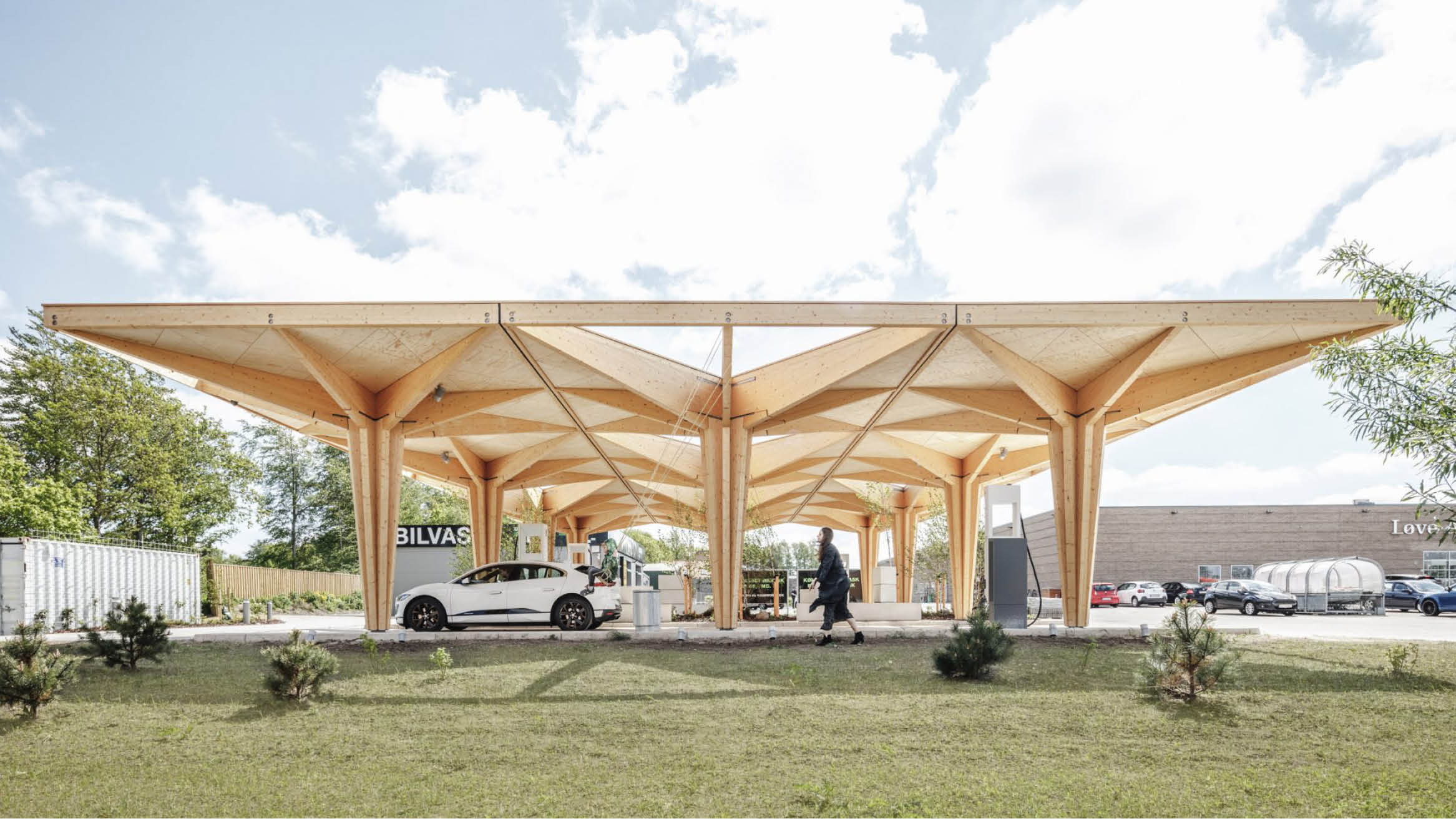 """Featured image for """"Cobe unveils pair of tree-like timber charging stations for electric cars in Denmark"""""""